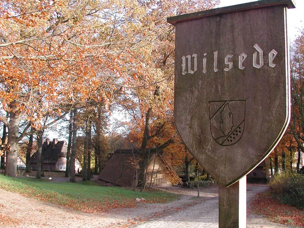 """Wooden village sign """"Wilsede"""" in autumn"""